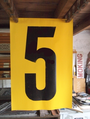 A hand cut numeral measuring 600mm tall.
